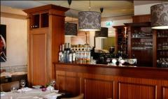 In het centrum van Geldrop, schuin tegenover de Brigidakerk, vindt u restaurant \